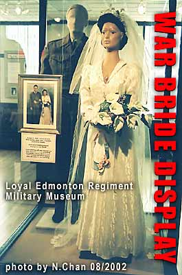 War Bride - bridal gown of Jane Allan who married James Todd, soldier fr. Alberta, in Scotland 1945 - from RATION CLOTHING COUPONS - display case in Edmonton Military Museum